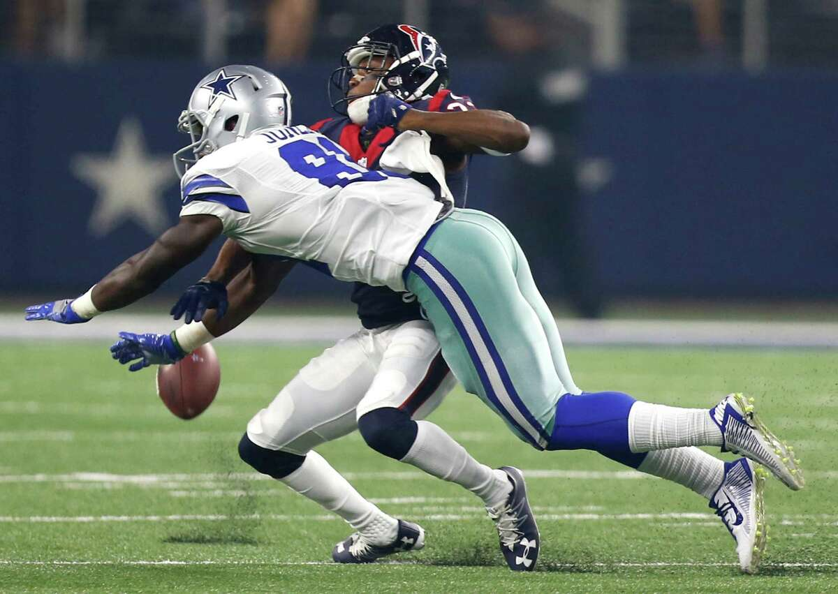 Houston Texans defensive back Robert Nelson (32) breaks up a pass intended for Dallas Cowboys wide receiver Andy Jones (81) during the second quarter of an NFL pre-season football game at AT&T Stadium on Thursday, Sept. 1, 2016, in Arlington, Texas.