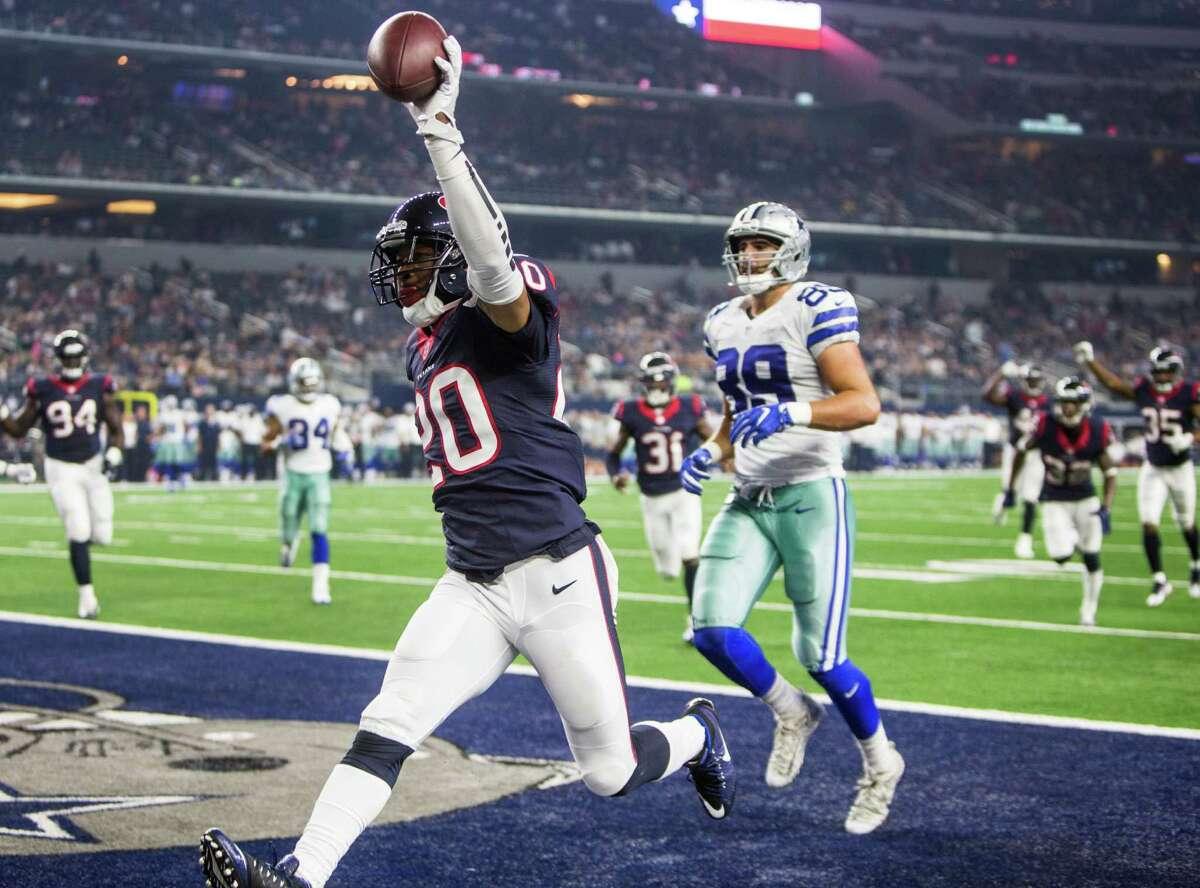 Houston Texans defensive back Antonio Allen (20) riuns past Dallas Cowboys tight end Gavin Escobar (89) for a nine-yard interception return for a touchdown during the fourth quarter of an NFL pre-season football game at AT&T Stadium on Thursday, Sept. 1, 2016, in Arlington, Texas.