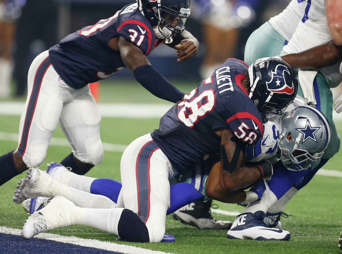 Houston Texans outside linebacker Reshard Cliett (58) tackles Dallas Cowboys running back Darius Jackson (34) behind the line of scrimmage during the fourth quarter of an NFL pre-season football game at AT&T Stadium on Thursday, Sept. 1, 2016, in Arlington, Texas.