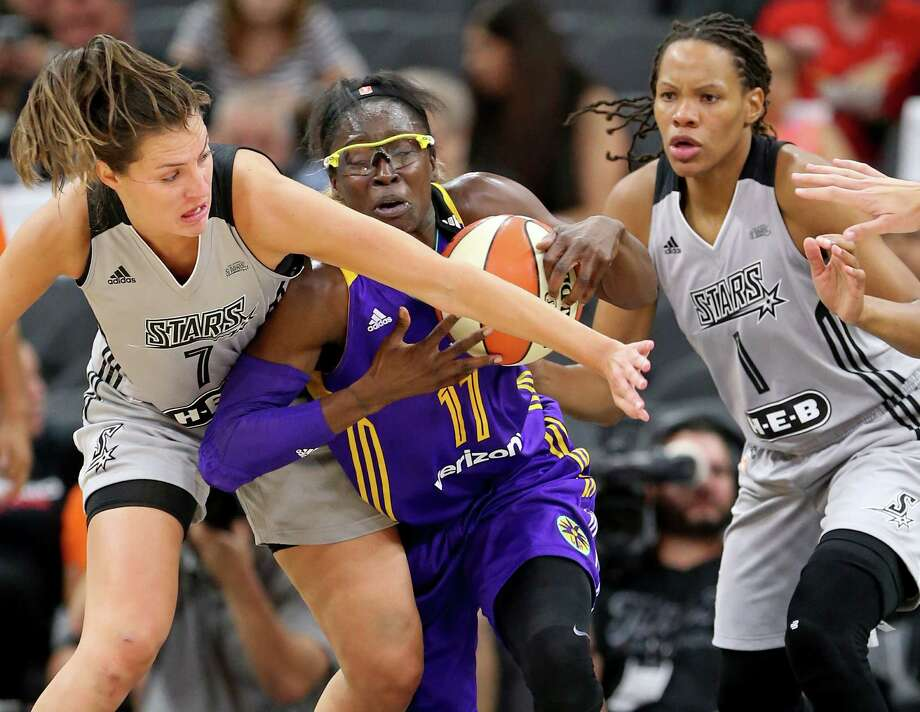 The Stars' Haley Peters (left) and the Sparks' Essence Carter battle for the ball during the first half of Los Angeles' victory Thursday night at the AT&T Center. Photo: Edward A. Ornelas / San Antonio Express-News / © 2016 San Antonio Express-News
