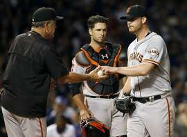 San Francisco Giants manager Bruce Bochy, left, takes the ball from relief pitcher Will Smith during the seventh inning of a baseball game against the Chicago Cubs, Thursday, Sept. 1, 2016, in Chicago. (AP Photo/Nam Y. Huh)