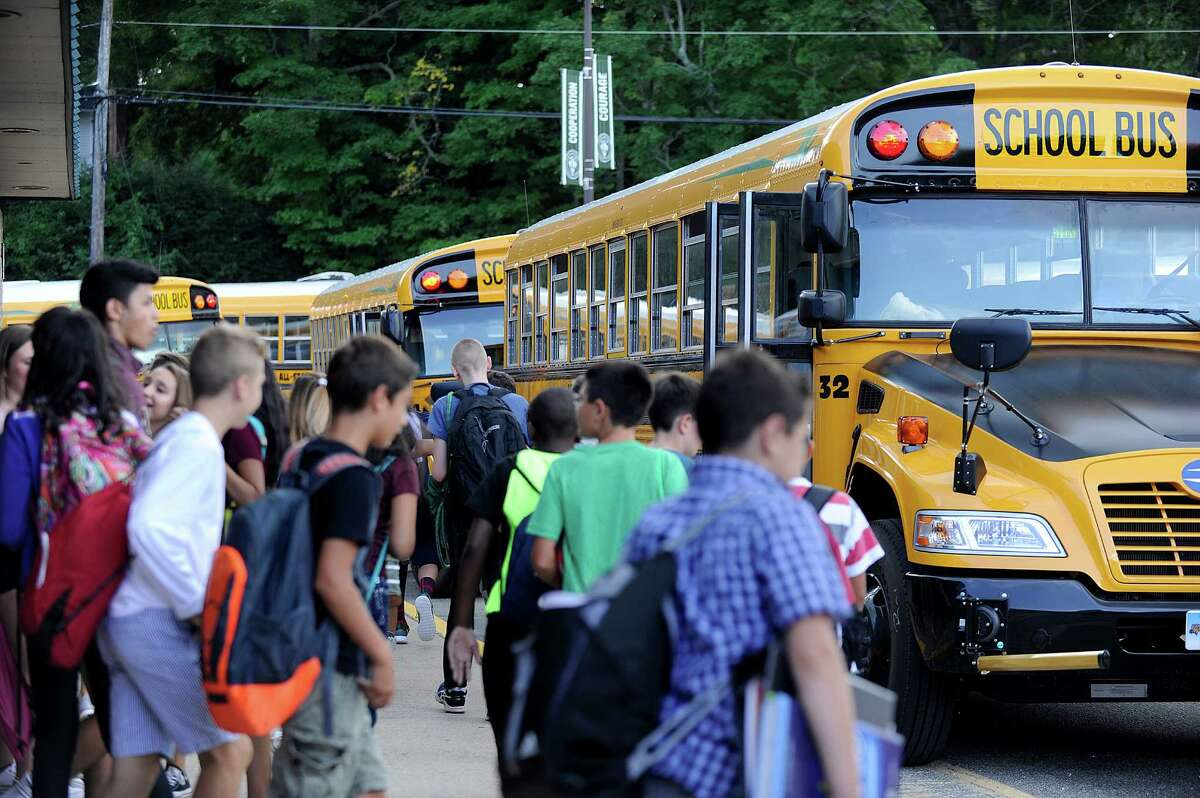 Students head for the buses at the end of the school day at Schaghicoke Middle School in New Milford, Thursday, Sept. 1, 2016. Some of the buses are propane-fueled.