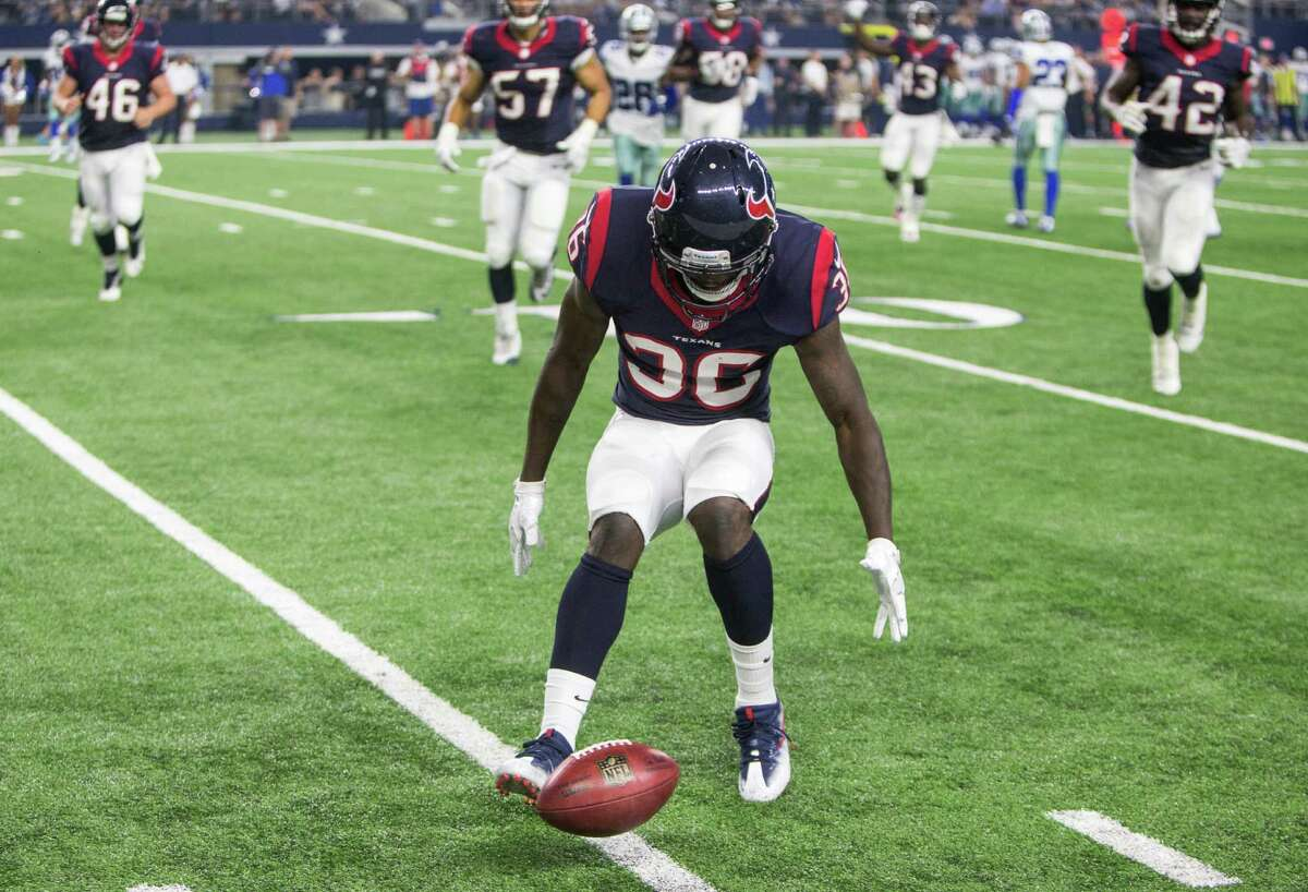Houston Texans safety K.J. Dillon (36) downs a punt inside the 10-yard line during the fourth quarter of an NFL pre-season football game against the Dallas Cowboys at AT&T Stadium on Thursday, Sept. 1, 2016, in Arlington, Texas.