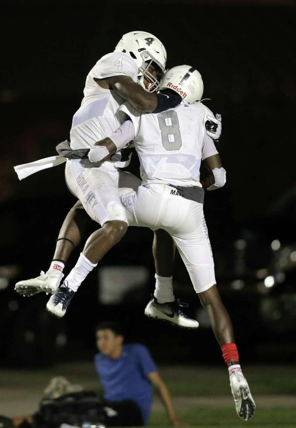Sept. 1: Manvel 26, North Shore 13 Manvel's Ceylon Stokes (4) and Kam Scott (8) celebrate Scott's touchdown in the fourth quarter against North Shore High Schools on Thursday, Sept. 1, 2016, in Houston. Manvel won the game 26-13.
