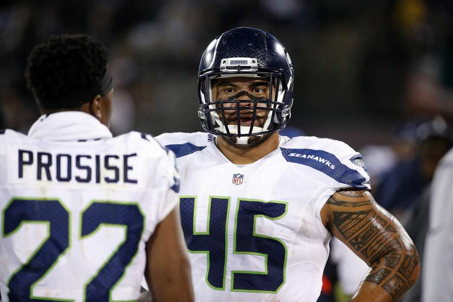 The Seahawks will reportedly add fullback Tani Tupou -- a University of Washington alum -- to their active roster after Saturday's trade for former San Francisco 49ers safety was reversed due to a failed physical. Photo: Tony Avelar/AP
