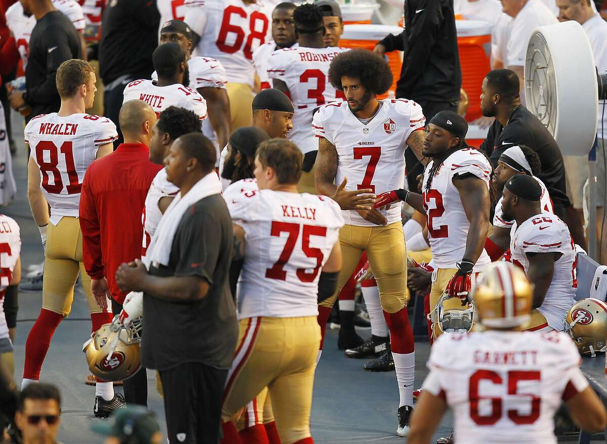 San Francisco 49ers quarterback Colin Kaepernick (7) greets players after taking a knee during the national anthem before a preseason game against the San Diego Chargers on Thursday, Sept. 1, 2016, at Qualcomm Stadium in San Diego. (K.C. Alfred/San Diego Union-Tribune/TNS)