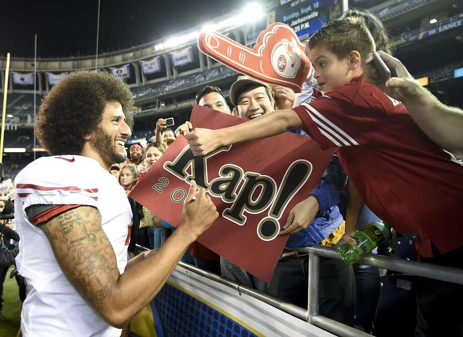 San Francisco 49ers quarterback Colin Kaepernick greets fans after their win against the San Diego Chargers during an NFL preseason football game Thursday. Photo: Denis Poroy, Associated Press