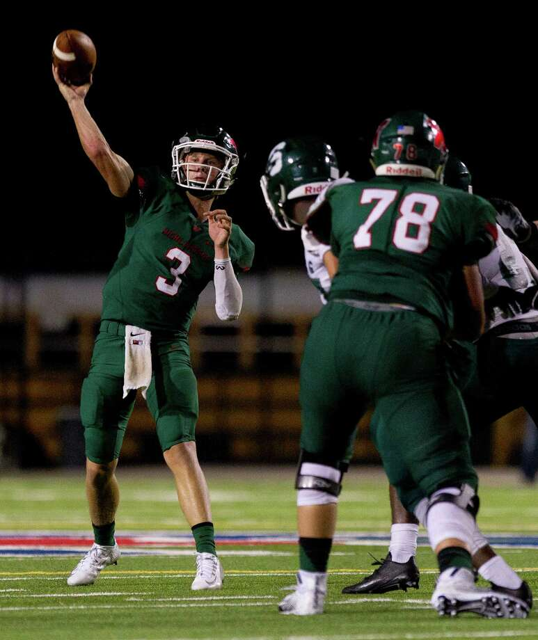The Woodlands quarterback Eric Schmid (3) throws a 31-yard touchdown pass to wide receiver Dylan Casey (2) during the third quarter of a non-district high school football game Thursday, Sept. 1, 2016, at Woodforest Bank Stadium in Shenandoah. The Woodlands defeated Spring 36-7. Photo: Jason Fochtman / Houston Chronicle