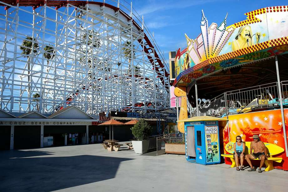 The Giant Dipper on the left at the Santa Cruz Boardwalk in Santa Cruz, Calif. The Santa Cruz Boardwalk has announced a major $12 million renovation to its main entrance, Fright Walk attraction and other rides. Photo: Craig Lee / Special To The Chronicle