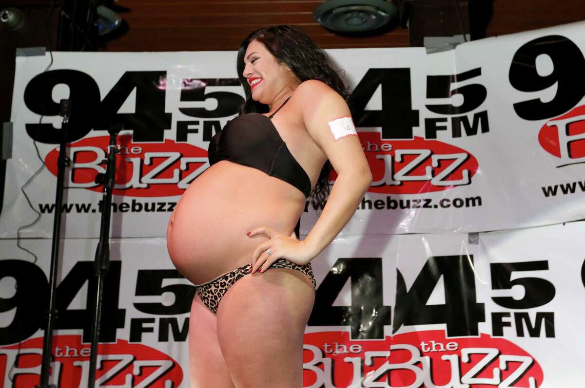 Ariel Munoz participates the 12th Annual Pre-Labor Day Pregnant Bikini Contest hosted by the Rod Ryan Show at The PUB Fountains Thursday, Sept. 1, 2016, in Stafford.