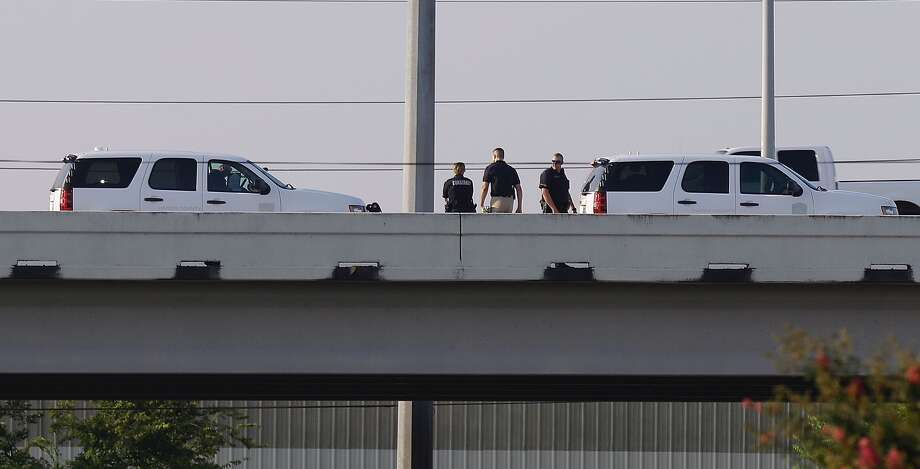 Police are shown at the scene of a fatal crash in the westbound lanes of Westpark Tollway at Beltway 8 Friday, Sept. 2, 2016 in Houston.  ( Melissa Phillip / Houston Chronicle )