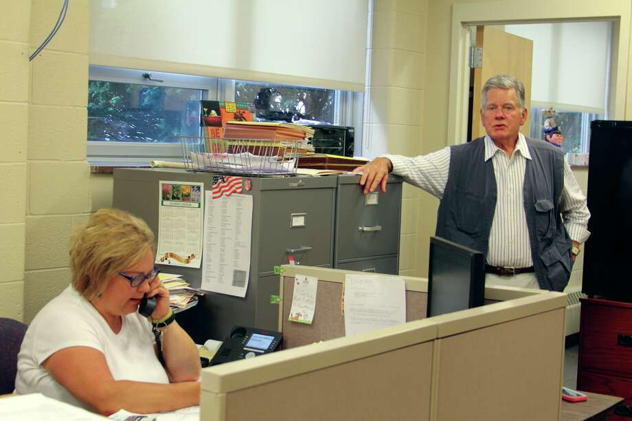 Karen Case, left and Steve Allen, right, work to take care of some of the county's most fragile personalities in the Huron County Public Guardian's office.