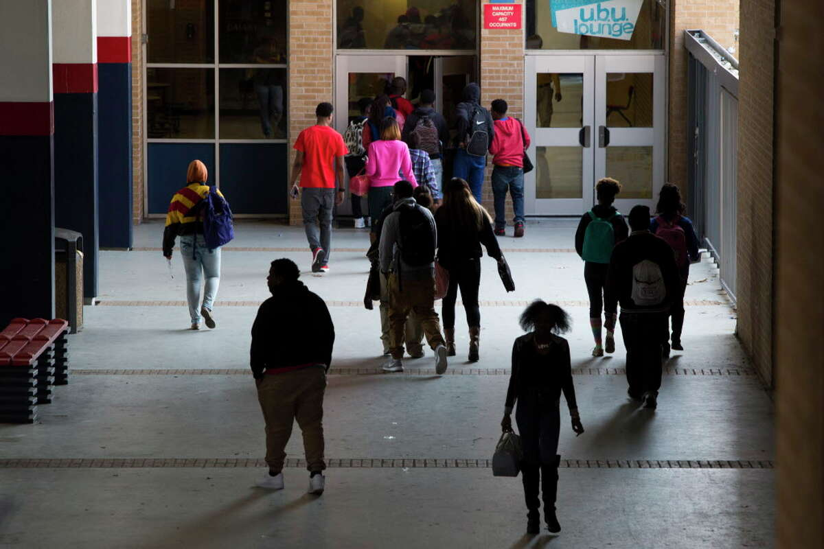 Students at Kashmere High School change classes in March 2015. The northeast Houston campus has failed to meet the state's academic standards for seven years.