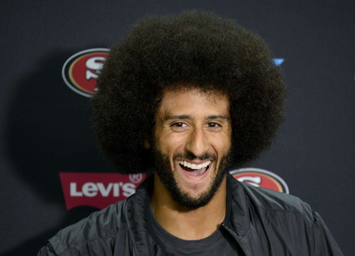 San Francisco 49ers quarterback Colin Kaepernick talks to the media at a news conference an NFL preseason football game against the San Diego Chargers on Sept. 1 in San Diego.
