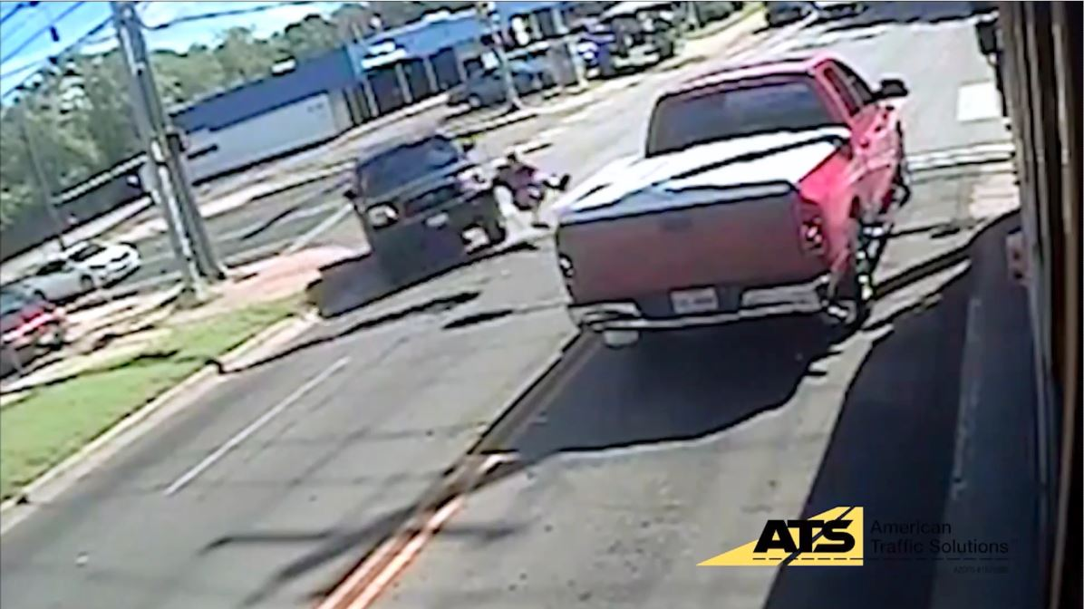 Video: 2 students run over by drivers refusing to obey bus