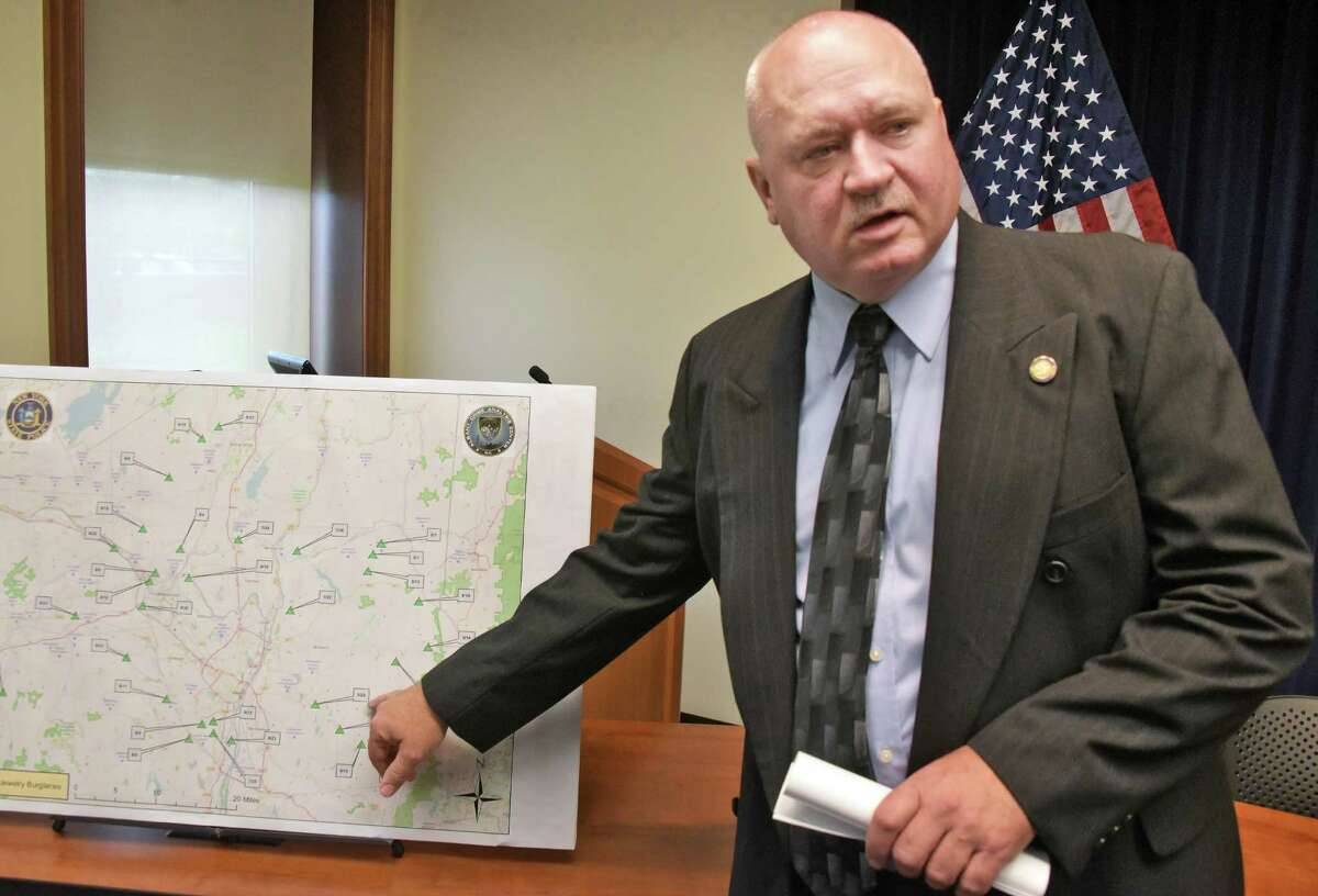 New York State Police Sr. Investigator Eric Cullum points to a map showing burglaries by Othe Pillow Case BanditO during a news conference at NYS Police headquarters Friday Sept. 2, 2016 in Colonie, NY. (John Carl D'Annibale / Times Union)