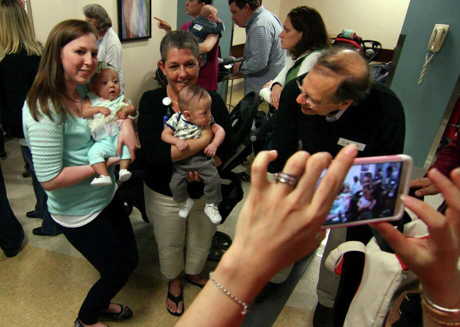 Bridgeport Hospital nurses Alison Cubbelloti and Julie Brown (L-R) pose in May 2016 with infants they cared for at the hospital's neonatal intensive care unit. Health care remains the runaway leader for state job projections, with the industry expected to add some 24,000 jobs through 2024 according to the Connecticut Department of Labor. Photo: Christian Abraham / Hearst Connecticut Media / Connecticut Post