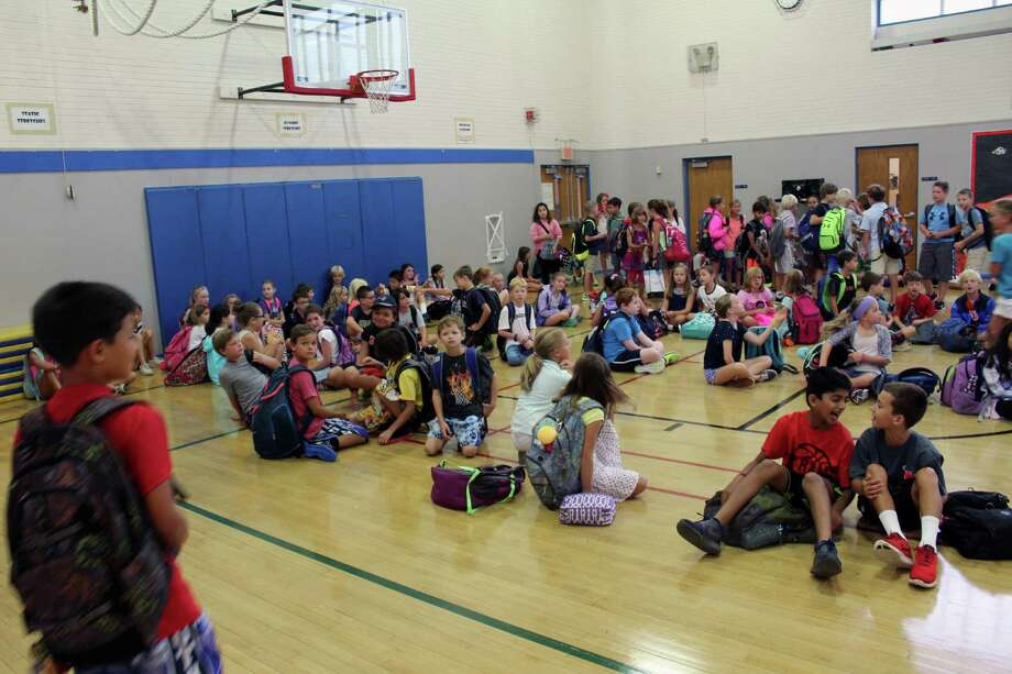 South Elementary School students fresh off the bus gather in the auditorium on the first day of school Sept. 1 in New Canaan, Conn. Photo: Justin Papp / Hearst Connecticut Media / New Canaan News