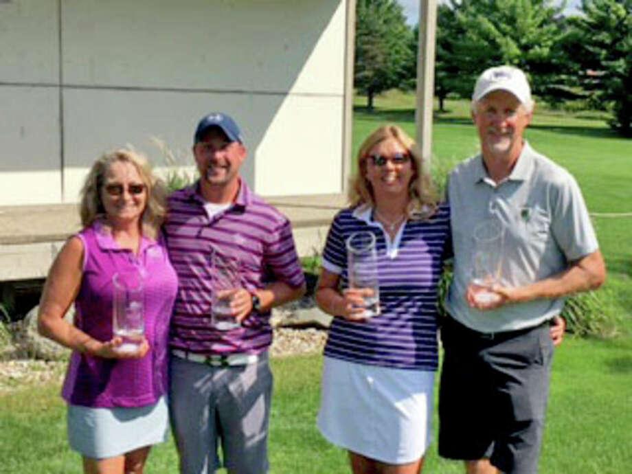 Verona Hills club champions (from left) Sue VanDeVusse (runner-up), Brett McBride (champion), Becky Lyon (champion), Mike Lyon (runner-up).