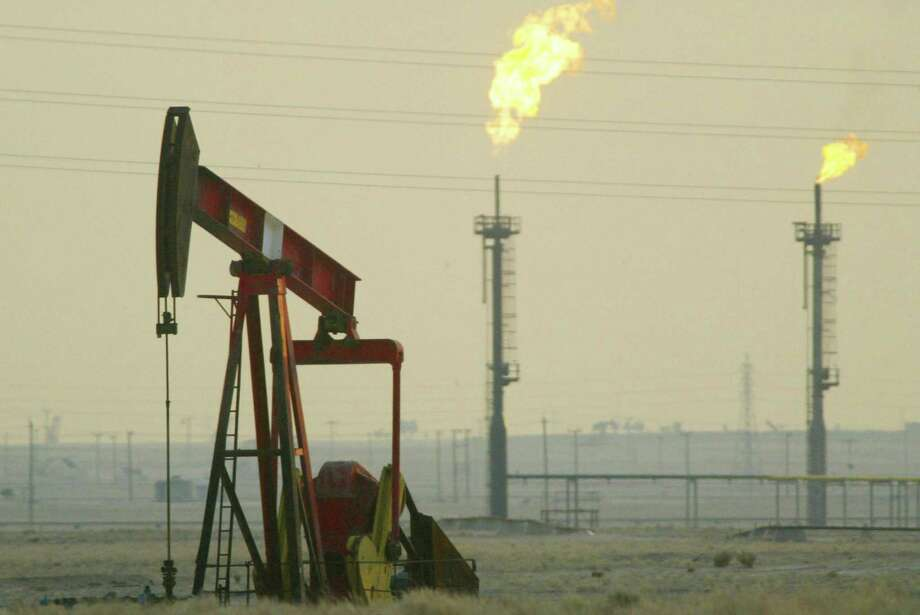 A derrick pumps in a Kuwaiti oil field near the Saudi Arabian border. Kuwait and other countries support prolonging production cuts that are scheduled to expire in June, the Persian Gulf emirate's oil minister, Issam Almarzooq, told state-run news agency KUNA. Photo: Getty Images /File Photo / 2003 Getty Images