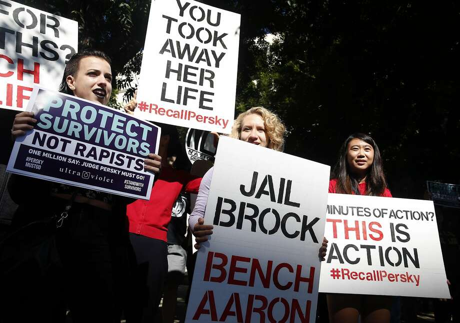 Protesters hold signs at a rally to call for Judge Aaron Persky's removal from the bench across the street from the Santa Clara County Main Jail in San Jose, Calif. on Sept. 2, 2016. Brock Turner was released from jail earlier in the morning after serving half of a six month sentence issued by Persky after Turner was found guilty of raping an unconscious female student. Photo: Paul Chinn, The Chronicle