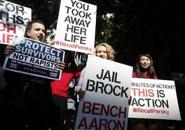 Protesters hold signs at a rally to call for Judge Aaron Persky's removal from the bench across the street from the Santa Clara County Main Jail in San Jose, Calif. on Sept. 2, 2016. Brock Turner was released from jail earlier in the morning after serving half of a six month sentence issued by Persky after Turner was found guilty of raping an unconscious female student.