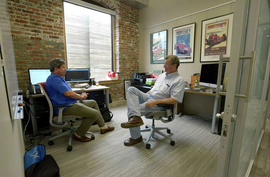 From left, Peter Neumann and Steve Linden, both of Chrome Strategies Management meet Neumann's office space at Serendipity Labs, a new shared working complex at 700 Canal Street in Stamford, Conn. on Sept.1, 2016. Photo: Matthew Brown / Hearst Connecticut Media / Stamford Advocate