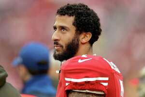 San Francisco 49ers quarterback Colin Kaepernick roams the sideline during an pre-season game against the Atlanta Falcons. A reader criticizes the player for refusing to stand during the National Anthem in what he termed a protest over the oppression of minorities in the United States.