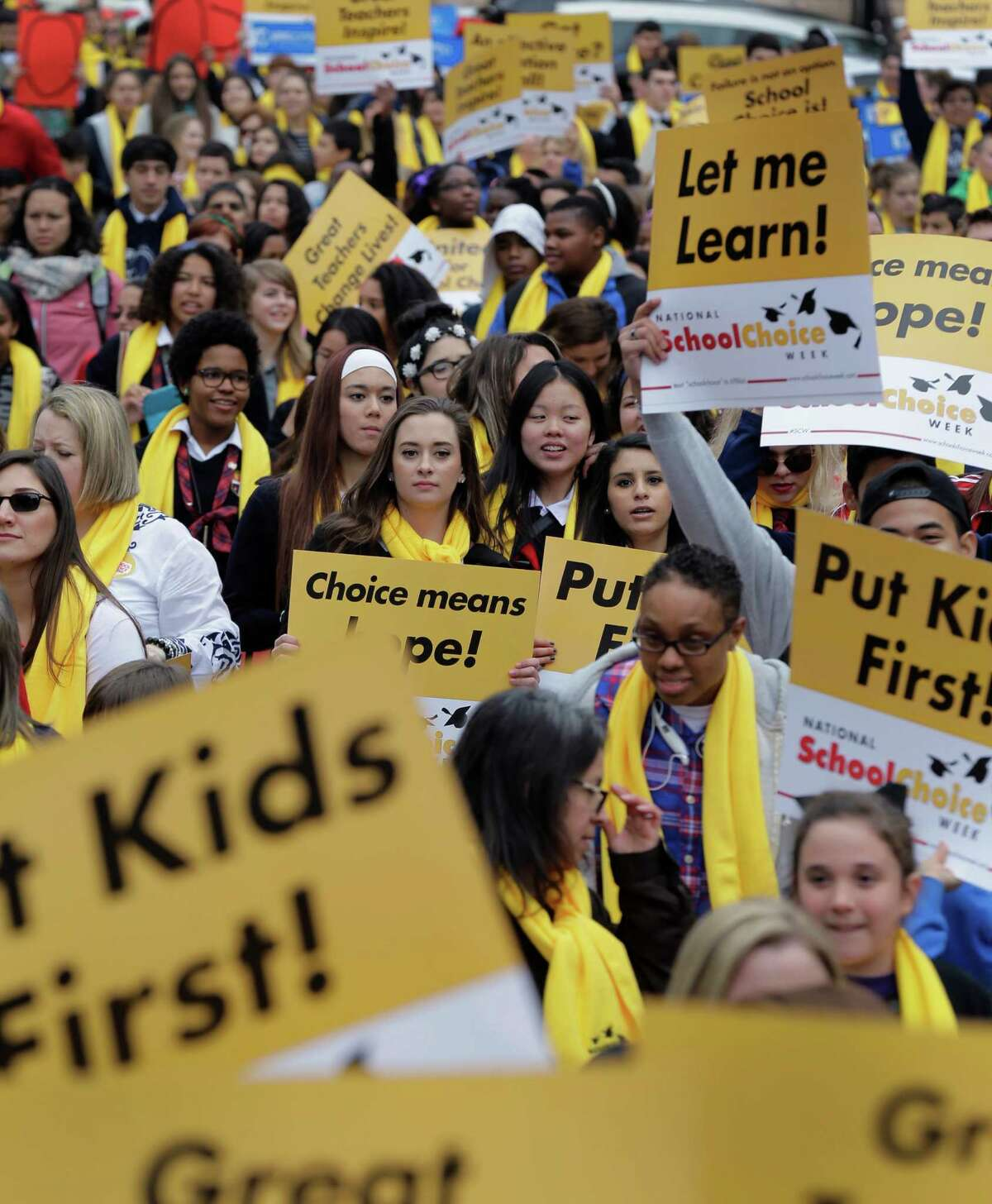 Students, teachers and supporters march on the grounds of the Texas Capitol Jan. 30, 2015, in Austin, Texas. School choice supporters called for expanding voucher programs and charter schools statewide. That call may be replaced in January in a new legislature with efforts to create education savings accounts.