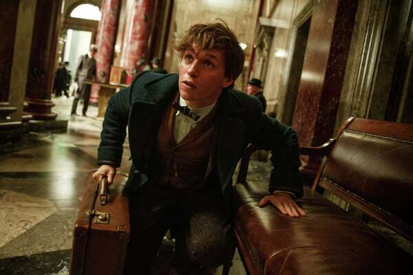"This image released by Warner Bros. Pictures shows Eddie Redmayne in a scene from ""Fantastic Beasts and Where to Find Them,"" scheduled for release on Nov. 18, 2016. (Jaap Buitendijk/Warner Bros. Pictures via AP)"