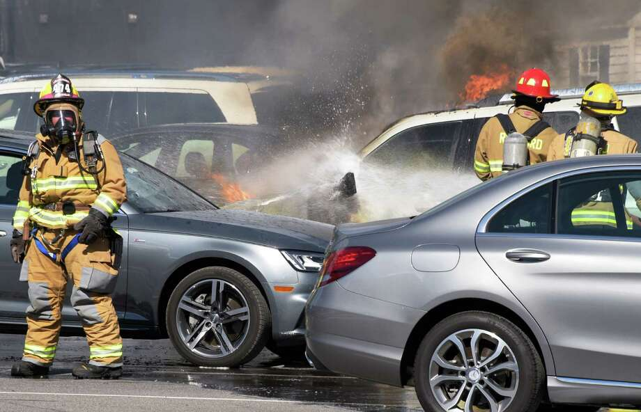Firefighters from Rexford and Jonesville battle a car fir in the parking lot of the Edison Club Friday Sept. 2, 2016 in Rexford, NY.  (John Carl D'Annibale / Times Union) Photo: John Carl D'Annibale