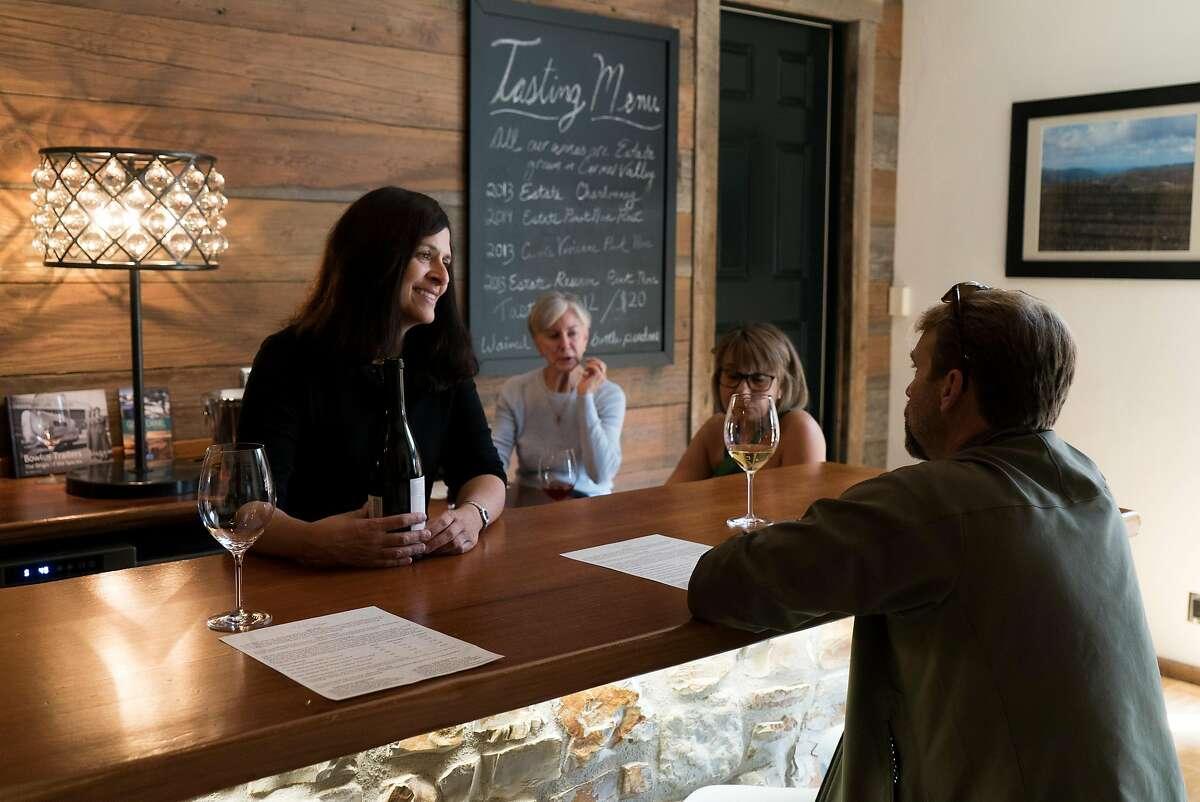 Lori Monteleone speaks with Joe Faxon at the Albatross Ridge Winery tasting room in Carmel, Calif. on Wednesday, Aug. 24, 2016. Albatross Ridge is located on Mission Street between Ocean and Seventh.