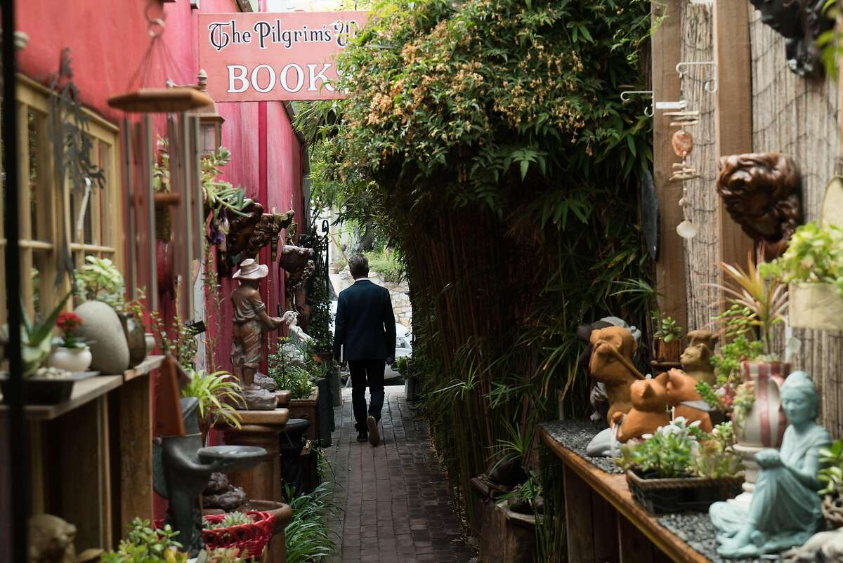 A man walks through the Secret Garden at Pilgrim's Way Bookshop in Carmel, Calif. on Friday, Aug. 19, 2016. Pilgrim's Way Bookshop features a secret garden in the back where visitors can relax.