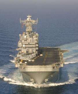 EDS NOTE: PICTURE MAY HAVE BEEN REVIEWED AS IT WAS SENT VIA NAVY COMMUNICATIONS--An aerial view taken Saturday Nov. 4,  2001 shows the American amphibious assault ship USS Peleliu, as it sails in the Arabian Sea. The USS Peleliu is currently supporting U.S.-led military operations in Afghanistan.  (AP Photo/Nicholas Kamm/Pool)