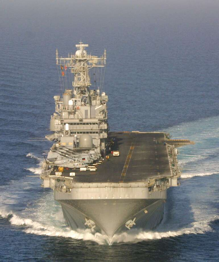 EDS NOTE: PICTURE MAY HAVE BEEN REVIEWED AS IT WAS SENT VIA NAVY COMMUNICATIONS--An aerial view taken Saturday Nov. 4,  2001 shows the American amphibious assault ship USS Peleliu, as it sails in the Arabian Sea. The USS Peleliu is currently supporting U.S.-led military operations in Afghanistan.  (AP Photo/Nicholas Kamm/Pool) Photo: NICHOLAS KAMM, AP