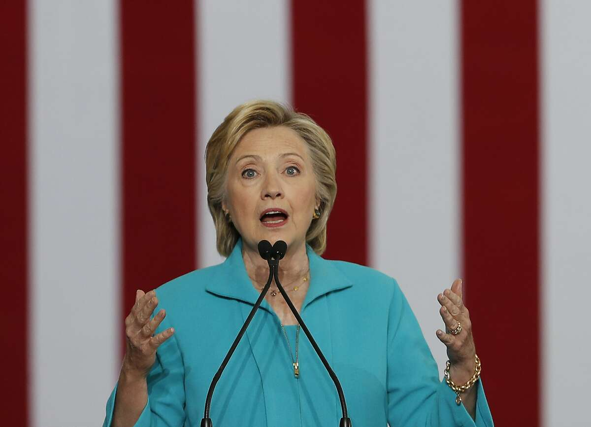 FILE - In this Aug. 25, 2016 file photo, Democratic presidential candidate Hillary Clinton speaks at a campaign event in Reno, Nev. The 2016 presidential election features two candidates with dramatically different approaches on immigration. In tone, Republican Donald Trump often highlights violent crimes perpetrated by immigrants in the country illegally with aggressive rhetoric that seizes on nationalism if not xenophobia. Democrat Hillary Clinton features a softer approach that embraces diversity and the value of keeping immigrant families together, even as her critics accuse her of promoting
