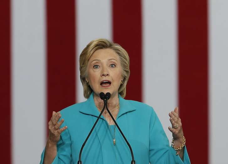 """FILE - In this Aug. 25, 2016 file photo, Democratic presidential candidate Hillary Clinton speaks at a campaign event in Reno, Nev. The 2016 presidential election features two candidates with dramatically different approaches on immigration. In tone, Republican Donald Trump often highlights violent crimes perpetrated by immigrants in the country illegally with aggressive rhetoric that seizes on nationalism if not xenophobia. Democrat Hillary Clinton features a softer approach that embraces diversity and the value of keeping immigrant families together, even as her critics accuse her of promoting """"open borders."""" (AP Photo/Carolyn Kaster, File)"""