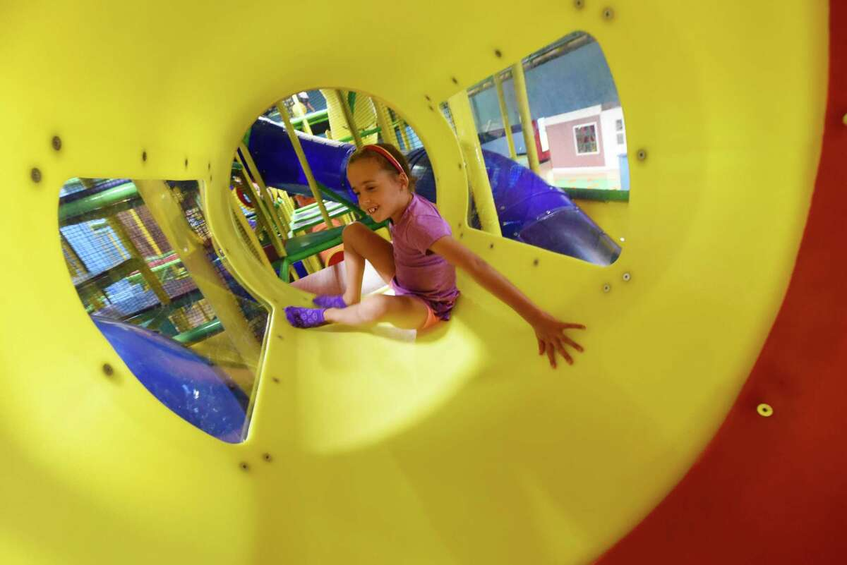Julia Maylock, 7, of Rexford wriggles through a tunnel at Billy Beez in Crossgates Mall on Friday, Sept. 2, 2016, in Guilderland, N.Y. The indoor playground is located above Best Buy. (Will Waldron/Times Union)