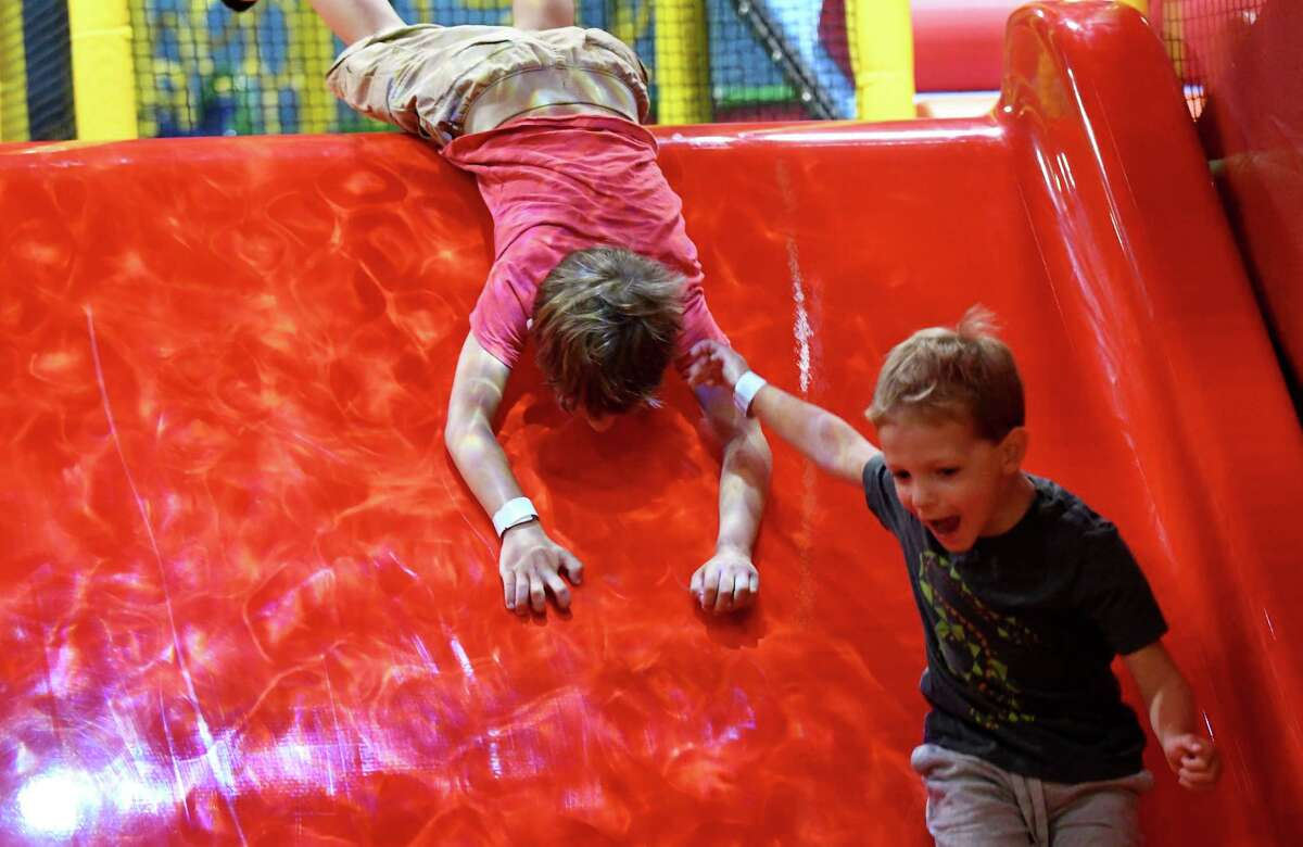 Lorenzo Steinke, 6, left, and his brother, Xavier, 4, right of Troy enjoy one the many slides at Billy Beez in Crossgates Mall on Friday, Sept. 2, 2016, in Guilderland, N.Y. The indoor playground is located above Best Buy. (Will Waldron/Times Union)