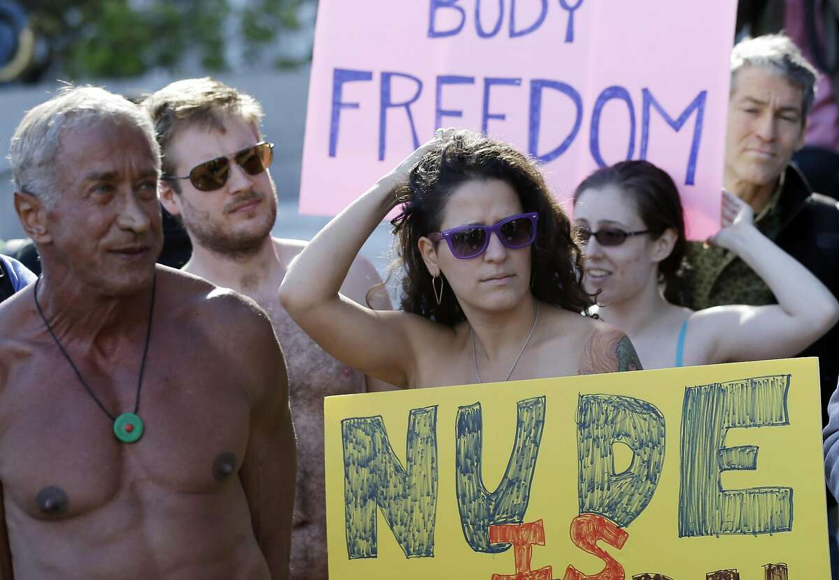 Demonstrators gather outside of City Hall in San Francisco for a protest against a proposed city-wide nudity ban, Wednesday, Nov. 14, 2012. San Francisco appears poised to shed part of its image as a city where anything goes, including clothing. The Board of Supervisors is scheduled to vote next week on a law that would ban public nudity. The proposal comes in response to a devoted group of nudists who proudly strut their stuff through the city's Castro District.