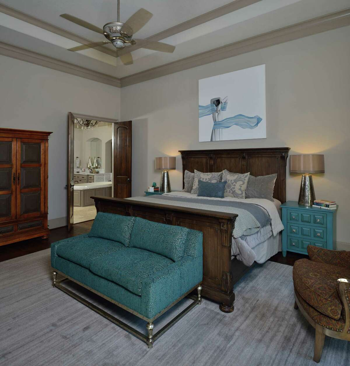 The master bedroomfeatures neutral walls and pops of Shari Ziebarth's favorite color, turquoise.