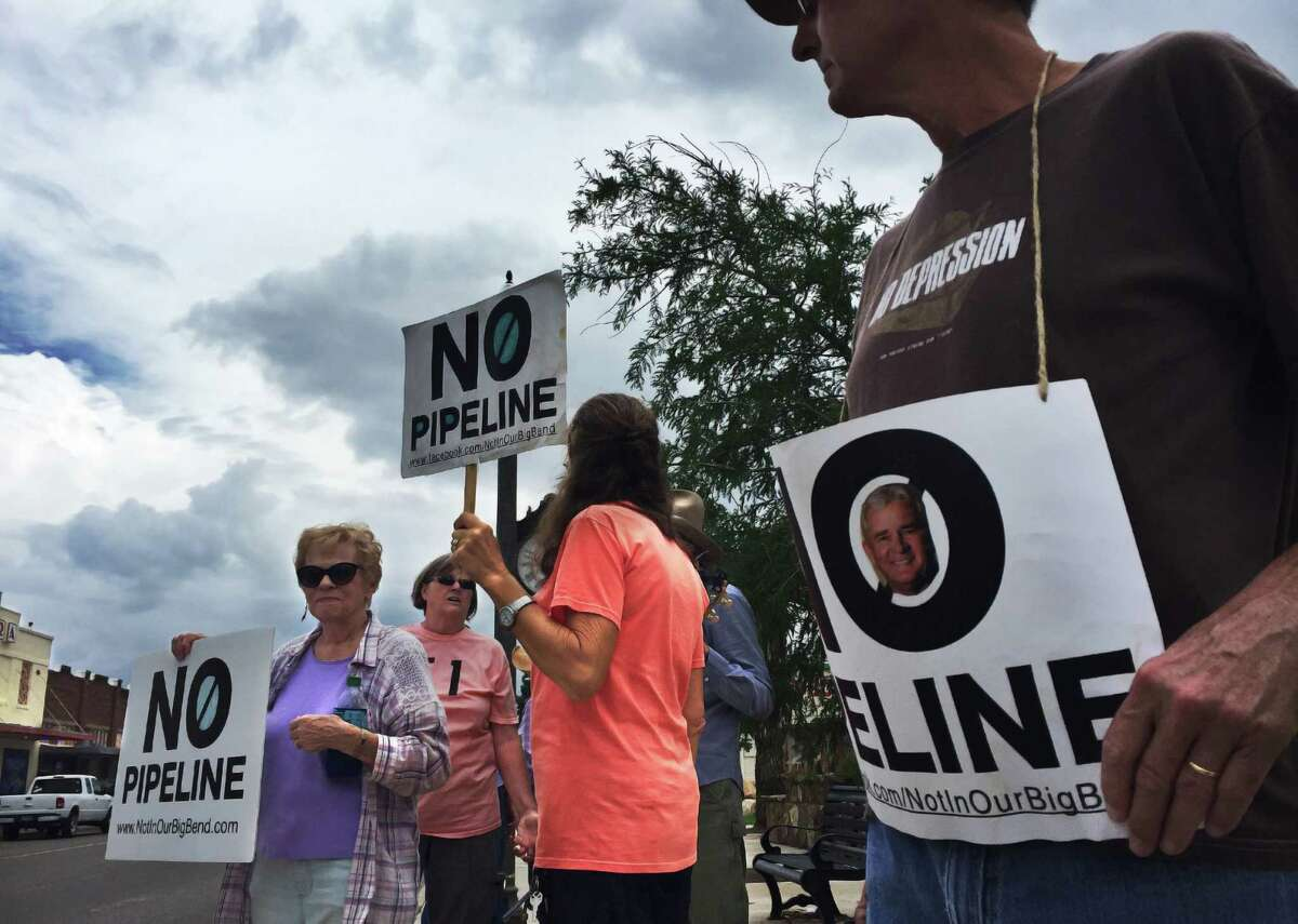 For more than a year, supporters of Defend Big Bend have protested in Alpine each Friday against the Trans-Pecos Pipeline. Suzanne Bailey, far left, Chris Sweeney, far right, and others took to the street again on Aug. 18 as construction of the line was proceeding a few miles away.