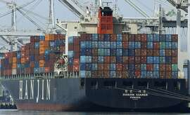 In this Wednesday, March 2, 2016, photo, the container ship Hanjin Xiamen waits to be unloaded at the Port of Oakland, in Oakland, Calif. On Friday, March 4, the Commerce Department reports on the U.S. trade gap for January. (AP Photo/Ben Margot)