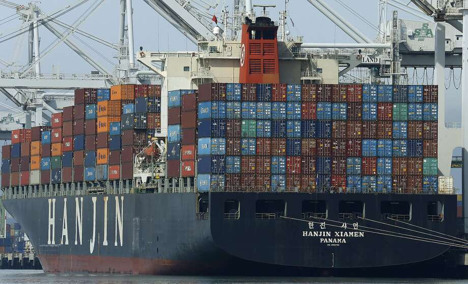 In this Wednesday, March 2, 2016, photo, the container ship Hanjin Xiamen waits to be unloaded at the Port of Oakland, in Oakland, Calif. On Friday, March 4, the Commerce Department reports on the U.S. trade gap for January. (AP Photo/Ben Margot) Photo: Ben Margot / Associated Press 2016