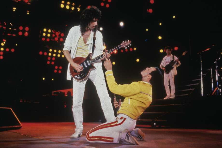 Singer Freddie Mercury (1946 - 1991) and guitarist Brian May of British rock band Queen in concert at Wembley Stadium, July 1986. (Photo by Dave Hogan/Getty Images) Photo: Dave Hogan/Getty Images