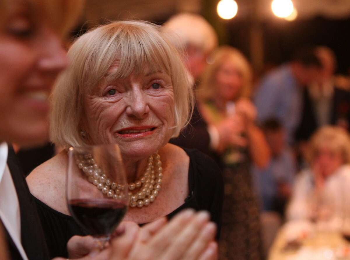 Margrit Mondavi listening to Peter Mondavi talk about his brother before the start of the last lot which was in tribute to Robert Mondavi at the annual Auction Napa Valley taking place on the golf course at Meadowood Resort in St. Helena, Calif., on Saturday, June 7, 2008. Photo by Liz Hafalia/The Chronicle