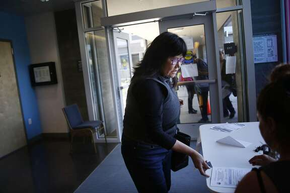 Yelena Makarov puts in a rental housing application for her father at Willie B. Kennedy Apartments on Friday, September 2,  2016 in San Francisco, California.