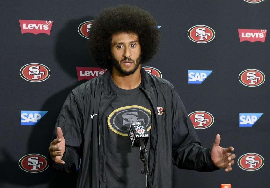 Colin Kaepernick said locker room discussions about why he's taken his stance have been beneficial for the team. Photo: Denis Poroy, Associated Press