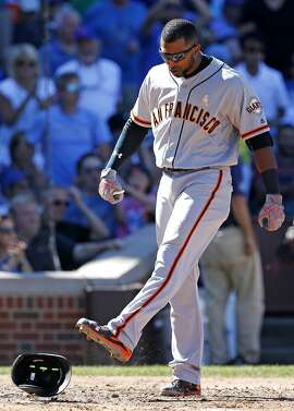 San Francisco Giants' Eduardo Nunez kicks his helmet after lining out sharply to Chicago Cubs third baseman Kris Bryant during the seventh inning of a baseball game Friday, Sept. 2, 2016, in Chicago. (AP Photo/Nam Y. Huh)
