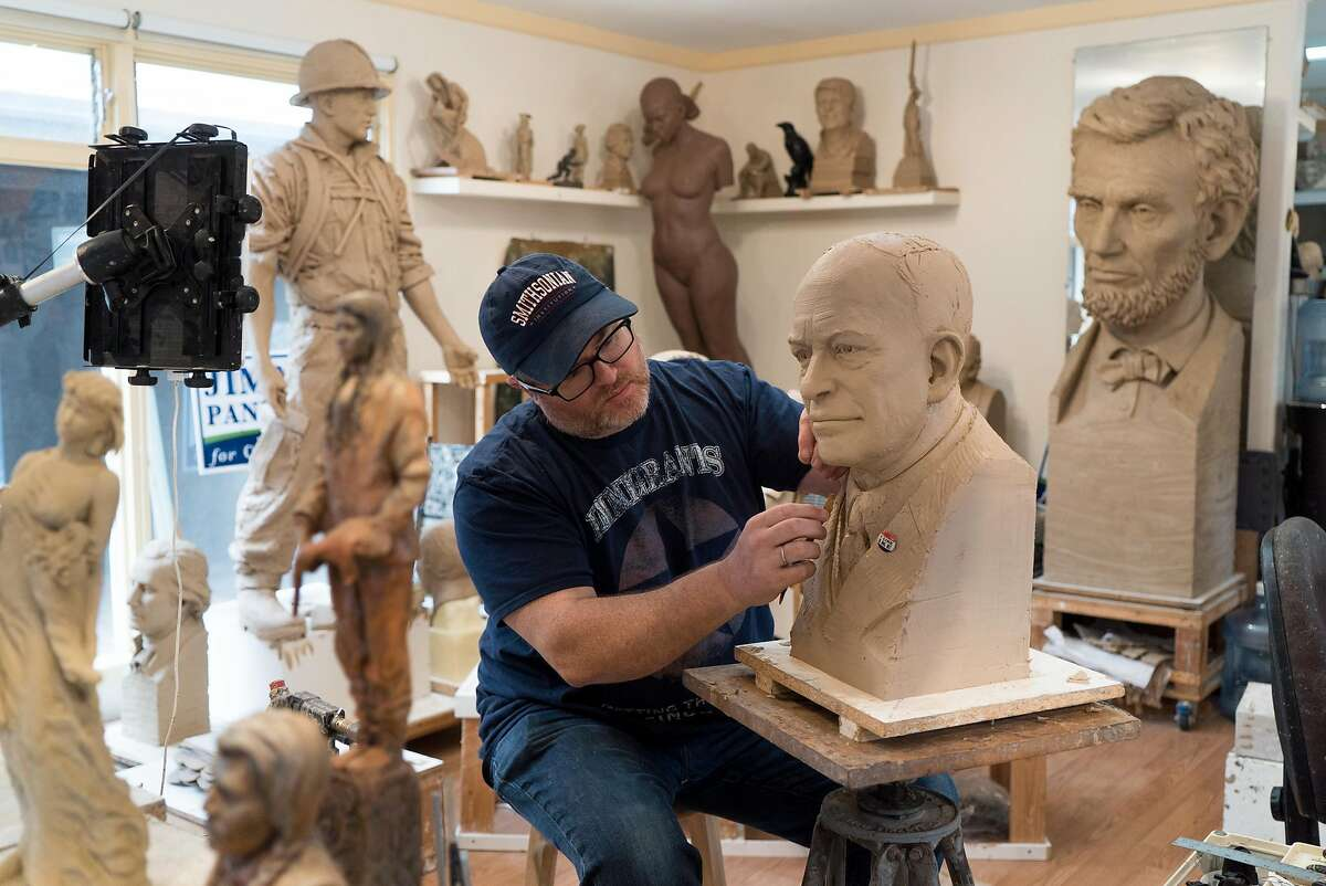 Steven Whyte works on a commissioned sculpture in his studio on Dolores Street in Carmel, Calif. on Friday, Aug. 19, 2016. Whyte is joined by his dog Lord Wellington everyday in the studio.